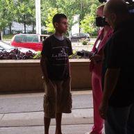 teenage boy with reporter